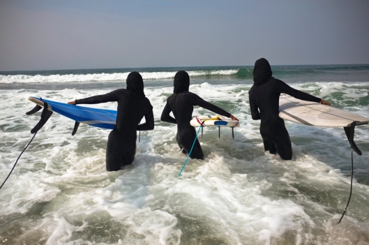 three muslim women from Bahrain go surfing wearing Burqa's in Santa Monica, CA 9/15/11